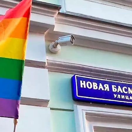 Punk rock group Pussy Riot hangs LGBT flags on Moscow buildings
